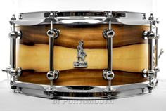 Brady Red Iron Bark Ply Snare Drum 6.5x14 Blackheart Gloss Hear how it sounds! http://youtu.be/tOrZ4rpvoKQ Available for purchase here! http://www.drumcenternh.com/brady-red-iron-bark-block-snare-drum-6-5x14-natural-gloss.html