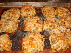 Buttermilk, sausage, and cheese biscuits.  With more sausage, and more cheese.  Served with sausage gravy.