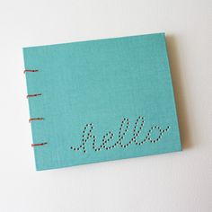 I think we could do this!  Take chipboard, pierce the word through it and bind your own album.  Viola!  Cheaper and more personal.