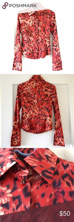 Red satin animal print button down shirt A stunning, red & black leopard print shirt made from high quality stretch satin. Floral print adds a feminine flair, buttons are understated and elegant. The shirt has an excellent tailored fit. Purchased abroad in Japan when traveling. Will fit size 2 or size 4. It's a well-made, high quality top. Worn a few times and stored after dry clean. Tops Button Down Shirts