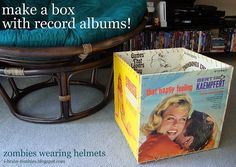 Another thing we sometimes have on our sale shelf are LPs, here's a tutorial for a box made of recycled album sleeves