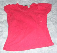 Used, glittery red top. Size M(Juniors)/Size S(Women's). Clean, comes from non-smoking/pet free home.