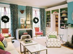 Colorful. Great mix of traditional and modern furnishings. Love the built-ins and the peek of library through the bookcases.  Also love the Christmas wreaths hanging on ribbons on the windows.