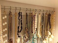 i'm coping this someday soon...Cabinet handle as necklace organizer.