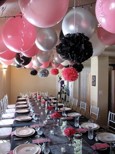 Hanging Air Filled Latex Balloons from ceiling. Using 36 inch Round Pink, Black and White Balloons and 30 inch Round Silver Balloons. Available at: BalloonWarehouse.com