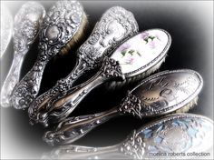 collection of antique sterling silver baby brushes