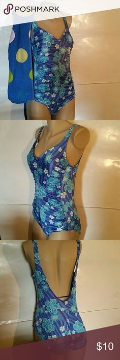 Maxine of Hollywood Swimsuit Tropic Floral 14 EUC Maxine of Hollywood Excellent used condition Flaw buttock bottom snags Few sections stringy.  NO rips NO stains  One piece swimsuit Cute elastic gathers each side trimming body shape Size 14 Beautiful blue and teal flowers Light padded brallette Tummy trimmer spandex 85% nylon 15% spandex Lining 82% nylon 18% Lycra/spandex Assembled in Taiwan of USA components Maxine of Hollywood Swim One Pieces