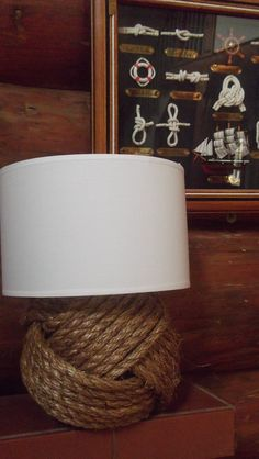 Nautical home decor - One nautical style rope lamp - with brown or white shade - nautical decor for your home, cottage, cabin or boat house. $70.79, via Etsy.