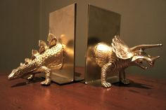 dinosaur bookends -diy  don't love the gold, but it would look cute in green.  Using plastic dinosaurs, cut in half, glued to a plastic picture frame and spray painted.  EAsy enough.