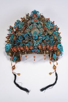 A RARE KINGFISHER BLUE FILIGREE HEADDRESS . Possibly from the Qing Imperial Court. The headdress is exquisitely ornate, inlaid with white jade, tourmaline, pearl beads, agate and other semi-precious stones. Late 19th century