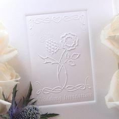 Thistle & Rose embossed wedding invitation