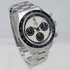 """Rolex Daytona Oyster Paul Newman - Step Dial - Référence 6263, de 1971.  Modèle chronographe à poussoirs vissés.    Cette montre est une des rares à avoir été certifiée par Rolex Genève Patrimoine comme ayant été vendue d'origine avec cadran exotique """"Paul Newman"""".   Accompagnée de ses papiers de révision Rolex Paris."""