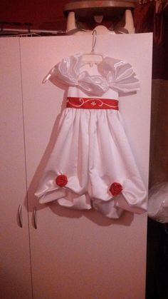 Flower girl dress. The sash is part of the train from the brides dress that I shortened.