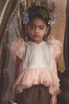 Tia Cibani natural kids fashion for fall 2017 is inspired by Frida Kahlo's love of nature. Botanicals and Aztec patterns were a constant in her work as well as her very intimate garden at Casa Azul and the collection is titled 'Art, Garden, Life' in honour of Frida. The collection for kids has sprung from the Tia Cibani adult line with direct connections between the two for Mama ...