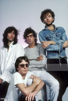 Photo of REM and Bill BERRY and Peter BUCK and Mike MILLS and Michael STIPE; Back L-R: Peter Buck, Bill Berry, Michael Stipe. Front: Mike Mills - posed, studio, group shot