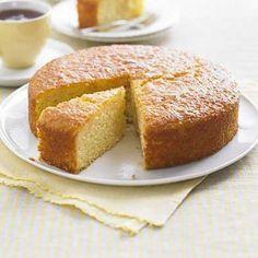 Surprise Your Family and Friends - Lighter Lemon Drizzle Cake: rapeseed oil, self rising flour, baking powder, ground almonds, polenta, lemon, golden caster sugar, large eggs, natural yogurt, caster sugar, lemon