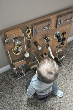 Sensory and motor skills homemade DIY wood board with locks, pulleys, etc