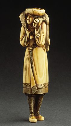 Dutchman with Deer Carcass, 18th century  Netsuke, Ivory with staining, sumi,