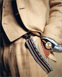 Tan suit and watch.