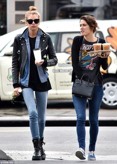 Details: Stella's hands were full with two green juices and a hot coffee. She was joined by a brunette gal pal who also grabbed two iced beverages to go