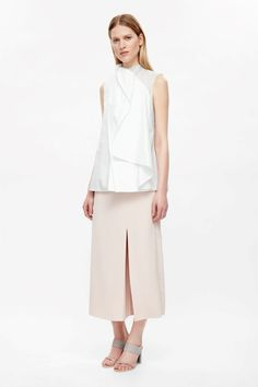 A draped, layered design, this top is made from cotton with a mulberry silk sheer detail. Sleeveless, it has a neat narrow neckline, minimal finishes and a hidden zip across the back shoulder.