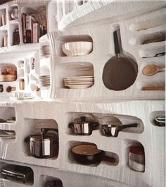 Plastic scraped out to the individual shapes of the dishes, pots and utensils in the kitchen. Unique storage idea.