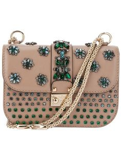 Pale brown clutch from Valentino featuring a flap design with green flower  jewel embellishments d1a16308ea4df