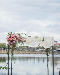 """""""Still in awe over this chuppah draped in florals and the brides's family's antique lace. Florals by the Flower Cart. Planner @sassysoiree  #chuppah…"""""""