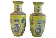 Pair yellow ground famille rose baluster-shaped porcelain vases from the Republic period.
