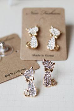 earrings - http://zzkko.com/n236108-he-new-fll-diamond-crown-peach-bottom-small-cat-earrings-gold-counters-authentic-Korean-fashion-female-gift.html $10.67