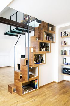 30 Under Stair Shelves and Storage Space Ideas - http://freshome.com/2012/04/12/30-under-stair-shelves-and-storage-space-ideas/