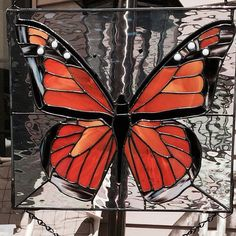 Stained Glass Monarch Butterfly 12 x 12 Inch This pic Does the piece no justice! Its a must see in the sun. Zinc frame and chain included! Iridescent water used for the outside glass. We love custom orders..... If you cant find what your looking for just ask we will be happy to make it.