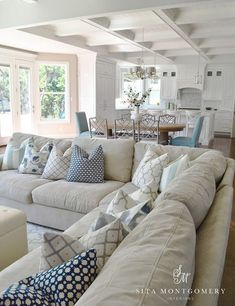 Love the vibe of this living room. Almost beach vibe with the neutral sectional and navy blue accents and coffered ceilings. Open layout  #OpenLatout #BeachStyle