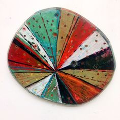Layered Disc #8 by Barbara Gilhooly. Acrylic, ink, and carving on disc shaped birch wood panel. Each piece is one of a kind.