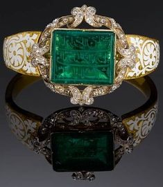 An inscribed Mughal emerald personal seal set in a diamond encrusted gold bangle