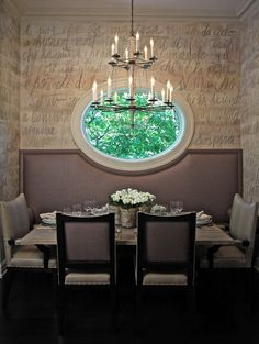 Just like a framed picture with the background of soft beige wall indoor, the oval window makes the green of leaves outdoor especially vivid and beautiful.