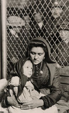 Portrait of an Italian mother and child who has just arrived at Ellis Island along with hundreds of other immigrants that day. Photograph taken by Lewis Hine in 1905. Lewis Hine was determined to portray the individuals, instead of the masses, in his photographs to humanize the immigrants arrived in the US. 1905.(Preus Museum)