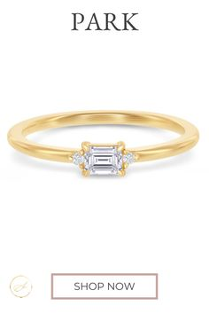 The emerald cut center diamond is set east-west giving this classic band ring a clean, modern vibe. Comes in Rose Gold, Yellow Gold and Platinum.