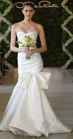 Oscar de la Renta Bridal 2013 ~ Ivory silk stretch radzimir sweetheart gown with drape bow trumpet skirt