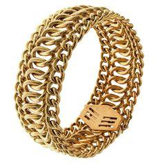 Wide Flexible Gold Link Bracelet  | From a unique collection of vintage link bracelets at https://www.1stdibs.com/jewelry/bracelets/link-bracelets/