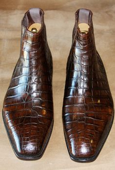 Brown alligator boots.