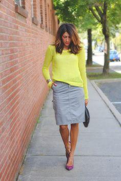 yellow sweater + grey skirt + purple pumps + black clutch