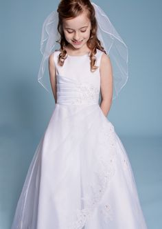 Cultural: Communion Dress Traditionally, girls wear white dresses and accessories on the day of their first communion in the US. White symbols purity, but also modesty.
