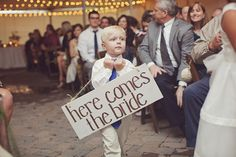maybe we could get Aiden to carry a sign?  fun idea..