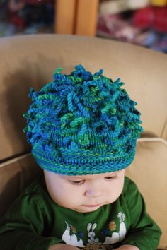 32071e7d43609 Because what s the point of having a baby if not to make him wear the most  ridiculous hats  Pattern  Anemone Hat by Cat Bordhi