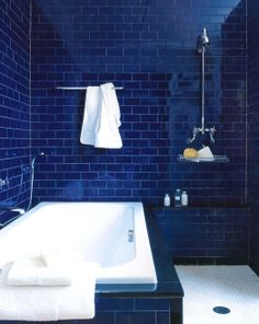 i love this but need light to be effective!  love the subway tile on walls and small tiles on the floor