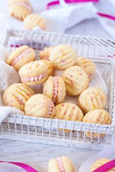 Melting Moments Cookies are a type of shortbread that melts in your mouth and these ones are filled with an easy Raspberry Buttercream. This is the best melting moments recipe EVER!