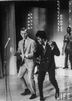 James Brown teaches Johnny Carson how to dance.