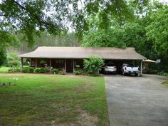 Adorable Rustic House, shaded by a beautiful oak, has 2 acres with 3 bedrooms and 2 baths.  Perfect front porch and side deck for lazy Sunday afternoons or family gatherings. Inside you will find high ceilings in the living room with exposed wood and the dining room is very quaint.  This home is a must see!  Schedule your showing appointment today.