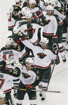 From bottom to top on right, Minnesota Wild left wing Pierre-Marc Bouchard, center Matt Cullen and defenseman Tom Gilbert celebrate with teammates after the Wild's 3-1 victory over the Colorado Avalanche in an NHL hockey game in Denver on Saturday, April 27, 2013. With the win, the Wild earned the eighth seed in the NHL Western Conference playoffs. (AP Photo/David Zalubowski) Hockey Games, Hockey Players, Ice Hockey, Minnesota Wild Hockey, Sports Quilts, Wild North, Hockey Boards, Western Conference, Colorado Avalanche
